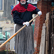 VENICE, ITALY - JANUARY 06:  A venetian boat heads to the Befana Regata with the rower dressed in a witch costume on January 6, 2011 in Venice, Italy.  In Italian folklore, Befana is an old woman who delivers gifts to children throughout Italy on Epiphany January 6 iin a similar way to Saint Nicholas or Santa Claus