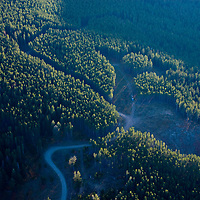 Roads and clear cut logging scar the southern Gallatin Range of the Rocky Mountains near Bozeman, Montana.