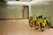 NHS Paramedic Responders' Specialized Rockhopper mountain bikes are propped up in Arrivals concourse at Heathrow's T5.
