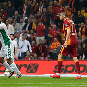 Galatasaray's Burak Yilmaz (2ndR) and TorkuKonyaspor's Ali Turan (L) during their Turkish Super League soccer match Galatasaray between TorkuKonyaspor at the AliSamiYen Spor Kompleksi TT Arena at Seyrantepe in Istanbul Turkey on Friday, 08 May 2015. Photo by Kurtulus YILMAZ/TURKPIX