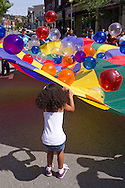 Middletown, New York - People enjoy playing with a parachute at the Middletown YMCA Funzone  during the Orange Regional Medical Center's Run 4 Downtown road race on Aug. 16, 2014.