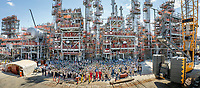 Construction crews gather for a team photo at a nearly completed processing unit at a South Louisiana petrochemical facility.