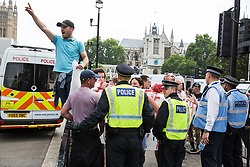 London, UK. 9th June, 2018. Supporters of Tommy Robinson, former leader of the far-right English Defence League, taunt anti-fascists protesting against the far-right March for Tommy Robinson in Parliament Street.