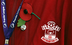 General view of a poppy on a jacket for Remembrance Day before the Premier League match at St Mary's Stadium, Southampton.