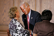 Sen. Joe Biden (D-DE) (R), vice presidential pick of presumptive Democratic Presidential nominee Sen. Barack Obama (D-IL), shakes hands with Washington Gov. Chris Gregoire (D) after a roundtable discussion on women's issues hosted by Michelle Obama in Denver, Colorado on August 26, 2008. The 2008 Democratic National Convention runs through August 28 in Denver. (UPI)