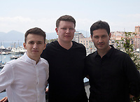 Actor Remzi Bilyalov, Director Nariman Aliev and actor Akthem Seitablaev at Evge (Homeward) film photo call at the 72nd Cannes Film Festival,  Thursday 23rd May 2019, Cannes, France. Photo credit: Doreen Kennedy