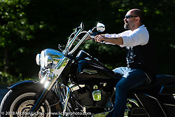 Riding Wilson Road near the Broken Spoke Saloon during Laconia Motorcycle Week. NH, USA. Saturday, June 16, 2018. Photography ©2018 Michael Lichter.