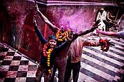 Holi festival, India, on thursday, mar. 10, 2009. Outside Bankey Bihari tempel in Vrindavan. Boys getting sprayed vith more color.