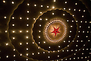The ceiling of the Great Hall of the People is illuminated with red star.