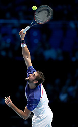 Marin Cilic plays a shot against Alexander Zverev during their singles match during day one of the NITTO ATP World Tour Finals at the O2 Arena, London.