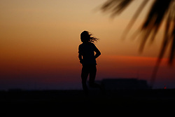 © Licensed to London News Pictures. 10/10/2018. Worthing, UK. People exercise on the sea front at first light in Worthing - with high temperatures expected later in the day. Photo credit: Peter Macdiarmid/LNP