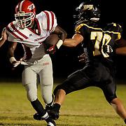 Jacksonville High School's Mario Jordan rushes past Topsail's Trae Blanton. (Jason A. Frizzelle)