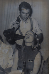 Hillary, Club 18-30's first female Rep drinks from a 'porron', wine offered by a waiter, in Majorca, 1973.<br />  John and Hilary Bond who met in Majorca at Club 18-30 in May 1973 where John was a Rep and Hilary a guest. This year the couple have just celebrated their 44th wedding anniversary. Watford, Herts, May 29 2018.