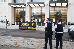 London, UK. 10 November, 2020. Metropolitan Police officers observe environmental activists from Extinction Rebellion protesting outside the Shell Centre on the 25th anniversary of the killings of the Ogoni Nine. The Ogoni Nine, leaders of the Movement for the Survival of the Ogoni People (MOSOP), were executed by the Nigerian government in 1995 after having led a series of peaceful marches involving an estimated 300,000 Ogoni people against the environmental degradation of the land and waters of Ogoniland by Shell and to demand both a share of oil revenue and greater political autonomy.