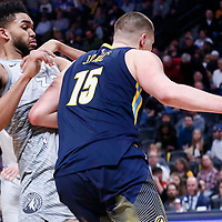 05 April 2018: Denver Nuggets center Nikola Jokic (15) drives past Minnesota Timberwolves center Karl-Anthony Towns (32) during the Denver Nuggets 100-96 victory over the Minnesota Timberwolves, at the Pepsi Center, Denver, Colorado, USA.