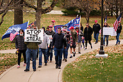 """21 NOVEMBER 2020 - DES MOINES, IOWA: About 100 supporters of US President Donald Trump gathered at the Iowa State Capitol to rally in support of the President and in opposition to the outcome of the US election. They are a part of the """"Stop the Steal"""" movement which has spread across the US. This is the third week that there have been """"Stop the Steal"""" rallies across the US. Most independent observers and election officials, both Republican and Democratic, have said the election was free and fair and that there was no election of fraud.     PHOTO BY JACK KURTZ"""