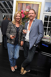 MARK BRAZIER-JONES and MARY GREENWELL at the after party for the press night of 'As I Like It' held at the home of Amanda Eliasch, 24 Cheyne Walk, London on 5th July 2011.