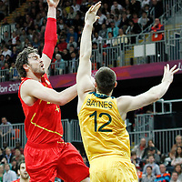 31 July 2012: Spain Pau Gasol goes for the skyhook over Australia Aron Baynes during the first half of Spain vs Australia, during the men's basketball preliminary, at the Basketball Arena, in London, Great Britain.