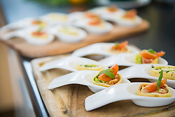 Pancake wraps as appetizers on porcelain spoons