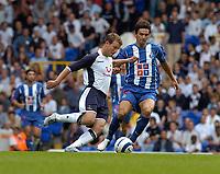 Photo: Leigh Quinnell.<br /> Tottenham Hotspur v Porto. Pre Season Friendly.<br /> 06/08/2005. Tottenhams Teemu Tainio in battle with Portos Helder Postiga.