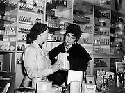 """Mr Eamon Andrews and Alma Cogan at Woulfes Pharmacy, Grafton St.01/12/1954..Alma Cogan (19/05/1932 - 26/10/1966) was an English singer of traditional pop music in the 1950s and early 1960s. Dubbed """"The Girl With the Laugh/Giggle/Chuckle In Her Voice"""", she was the highest paid British female entertainer of her era. Throughout the mid-1950s, she was the most consistently successful female singer in the UK."""