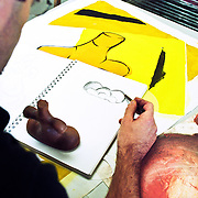 Male art student sketching in art class.
