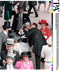 PAP ASC 8 20.6.95. ASCOT: The Princess Royal, watched by husband Cdr Tim Laurence (rear), is  greeted by Brig Andrew Parker Bowles on her arrival for the  first day of Royal Ascot today (Tuesday).  Photo by Martin Keene.PA.in.