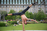 Acrobat from Gravity and Other Myths Circus, (Miguel Santana) practises his strength hand balancing act in Jubillee Gardens. The South Bank is a significant arts and entertainment district, and home to an endless list of activities for Londoners, visitors and tourists alike.