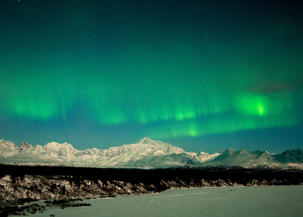 Alaska Range Mountains,  lit up with the Aurora Borealis or Northern Lights in the winter sky.<br /> Mt. McKinley (r); Mt Hunter (l) under full moon.