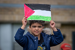 "© Licensed to London News Pictures. 16/05/2021. Oxford, UK. A boy holds a ""Free Palestine"" placard at the The 'Speak up for Palestine' demonstration held in Oxford, the crowd marched on the planned route from Manzil Way to Bonn Square in central Oxford. Photo credit: Peter Manning/LNP"
