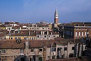 View of the city and the distinctive tiled rooftops of Venice from the Palazzo Contarini del Bovolo (also called Palazzo Contarini Minelli dal Bovolo). The Palazzo Contarini del Bovolo is a small palace in Venice, best known for the external spiral staircase with a plethora of arches, known as the Scala Contarini del Bovolo (of the snail). The palace dates from the 15th century and is apparently in poor state of restoration, while the staircase leads to an arcade provides a charming panoramic vista over some of the roof-tops of the city. The palace is located in a less-traveled side-street near the Campo Manin, near the Rialto...Subject photograph(s) are copyright Edward McCain. All rights are reserved except those specifically granted by Edward McCain in writing prior to publication...McCain Photography.211 S 4th Avenue.Tucson, AZ 85701-2103.(520) 623-1998.mobile: (520) 990-0999.fax: (520) 623-1190.http://www.mccainphoto.com.edward@mccainphoto.com.