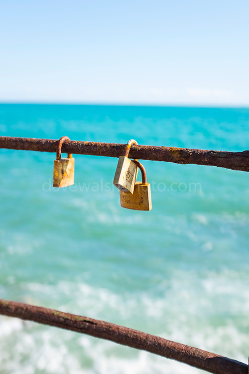 Love locks on rusty raililngs, Sant Pol de Mar, Catalonia