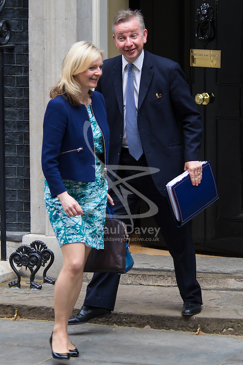 Downing Street, London, May 12th 2015. The all-conservatives Cabinet ministers gather for their first official meeting at Downing Street. PICTURED: Lord Chancellor and Secretary of State for Justice Michael Gove leaves with Elizabeth Truss, Secretary of State for Environment, Food and Rural Affairs