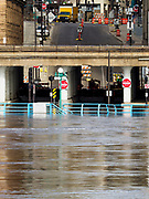 29 MARCH 2019 - ST. PAUL, MN: Mississippi River floodwaters have forced the closure of Jackson St. N in downtown St. Paul. The Mississippi River through the Twin Cities has already hit flood stage. Several roads and parks in St Paul are closed in anticipation of higher flood levels. Weather forecasters and hydrologists have backed off a little on earlier predictions of severe flooding because the snow melt has been slower than expected.     PHOTO BY JACK KURTZ