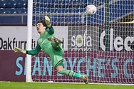 goalkeeper Lee Nicholls (1) fail to save Burnley midfielder Dale Stephens (16) scoring from the penalty spot during the FA Cup match between Burnley and Milton Keynes Dons at Turf Moor, Burnley, England on 9 January 2021.