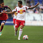 Tim Cahill, (right), New York Red Bulls, challenged by Benji Joya, Chicago Fire, during the New York Red Bulls Vs Chicago Fire, Major League Soccer regular season match at Red Bull Arena, Harrison, New Jersey. USA. 10th May 2014. Photo Tim Clayton