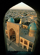 Mir-i-Arab Medressa, most famous mosque  in the the fabled city of Bukhara, on the ancient Silk Road. Viewed from top of the Kalon Minaret. Uzbekistan.