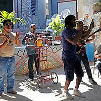 Central America, Cuba, Havana. Cuban beat poet and rapper plays at Muraleando Community Project.