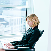 Business woman busy working on laptop in office