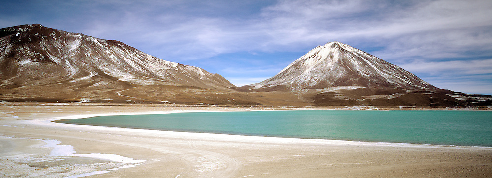 Laguna Verde is a salt lake in the southwest of the altiplano of Bolivia, Province of South Lipez on the Chilean border. Its colour is caused by sediments, containing copper minerals. It is elevated some 4,300 m above sea level.
