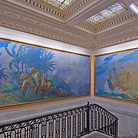 Paintings of classic exploration overhang the stairs leading to the formal boardroom at the National Geographic headquarters in Washington, DC.