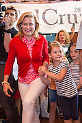 Heidi Cruz and daughter, Catherine, 4, arrive for a campaign event with husband U.S. Senator and GOP presidential candidate Ted Cruz at the Liberty Tap Room restaurant August 7, 2015 in Mt Pleasant, South Carolina. Cruz began a seven-day bus tour called the Cruz Country Bus Tour of southern states following the event.