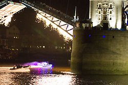 © Licensed to London News Pictures. 25/07/2012. London, UK. Fireworks explode from raised Tower Bridge bascules and a colourful boat passes through on 24th July 2012 in a rehearsal event believed to be related to the opening ceremony of the London 2012 Olympic Games. Photo credit : Vickie Flores/LNP