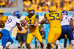 Oct 6, 2018; Morgantown, WV, USA; West Virginia Mountaineers quarterback Will Grier (7) drops back for a pass during the fourth quarter against the Kansas Jayhawks at Mountaineer Field at Milan Puskar Stadium. Mandatory Credit: Ben Queen-USA TODAY Sports