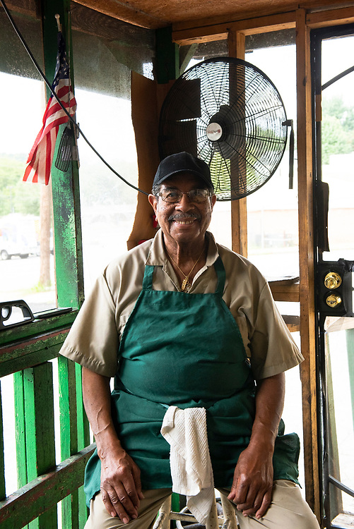 Oscar Wyatt of Wyatt's Country BBQ in Atlanta poses in his restaurant, a down-home hub offering BBQ & other Southern favorites.