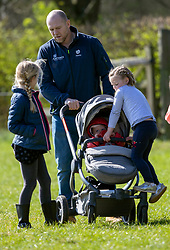 Mike Tindall with his daughters Mia (centre) and Lena Elizabeth (in buggy) and with Savannah Phillips (left) at the Land Rover Gatcombe Horse Trials, on Gatcombe Park, Gloucestershire.