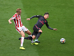 19 August 2017  : Premier League Football : Stoke City v Arsenal:  Darren Fletcher of Stoke fouls Mesut Ozil with a tackle from behind: Photo: Mark Leech