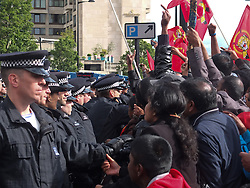 © licensed to London News Pictures. London, UK. 6/06/12. Protestors chant and throw items as the a vehicle believed to contain the Sri Lankan president leaves the hotel. Demonstration takes place outside the Hilton Hotel, Park lane, over the attendance of the Sri Lankan president Mahinda Rajapaksa, accused of presiding over human rights abuses, at the Commonwealth Lunch with the Queen. Photo credit: Jules Mattsson/LNP