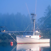 Boat on the Harrington River in the fog. Harrington, Maine