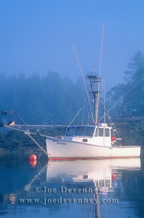 Boat on the Harrington River in the fog. Harrington, Maine